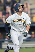 Michigan Wolverines catcher Harrison Wenson (7) runs to first base against the Michigan State Spartans during the NCAA baseball game on April 18, 2017 at Ray Fisher Stadium in Ann Arbor, Michigan. Michigan defeated Michigan State 12-4. (Andrew Woolley/Four Seam Images)