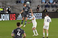 ST PAUL, MN - NOVEMBER 4: Aaron Schoenfeld #12 of Minnesota United FC with the header during a game between Chicago Fire and Minnesota United FC at Allianz Field on November 4, 2020 in St Paul, Minnesota.