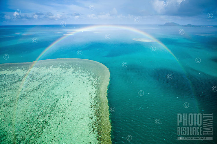 A full rainbow over a section of reef at the Kane'ohe Sandbar, Kane'ohe Bay, Windward O'ahu.