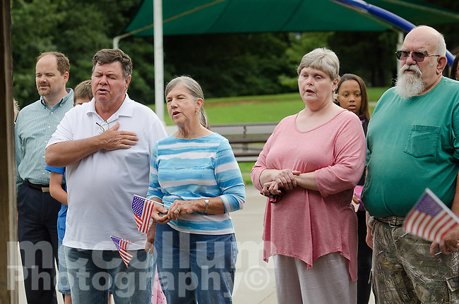 "Michael McCollum<br /> 8/2/18<br /> Attendees during the National Anthum at the reveal ceremony where it was announced to 13 year old Ryan Overman of west Knoxville that The Wish Connection is granting Ryan's wish to go to Washington DC and visit the White House at Carl Cowan Park, 10058 S Northshore Dr, Knoxville, TN , Thursday, August 2, 2018 at 5:45pm. Approximately 50-60 people attended, including the Overman family, friends, and AT&T Employees. The Bearden High School Cadets also attended and lead the pledge of allegiance.<br />  The AT&T Wish Connection is going to send Ryan, his family, and his service dog to Washington DC and while they are gone, the group of volunteers will be doing a makeover on his bedroom and turn it into the ""Oval Office"" at the White House.<br /> Ryan was born two weeks prematurely on May 13, 2005.  During the pregnancy he was classified as high risk due to a measured lack of growth and, after a brief stay in the hospital, he came home weighing only 4 lbs 5 oz.  His development was much slower compared to his peers, such as not learning to walk until he was well over a year old, and he was much smaller. The Overman family worked with Tennessee Early Intervention Services (TEIS) when Ryan was about one year old and with their help they were able to get Ryan enrolled through TEIS to receive Occupational, Physical, and Speech Therapy.  When Ryan turned three he transitioned from TEIS to the Knox County Early Intervention Program and began attending a special school to continue his therapies until he was old enough to enroll at Cedar Bluff Elementary and now is at Cedar Bluff Middle School. In 2016, Ryan was diagnosed to have retinitis pigmentosa, a degenerative disease of the retinas that under the best of circumstances causes severe tunnel vision, but more commonly results in complete blindness.<br />  Despite the physical difficulties that Ryan has had to endure over the last thirteen years, he continually brightens the lives of those around him.  If someon"
