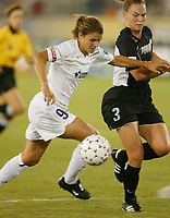 Mia Hamm of the Washington Freedom tries to get by Christie Pearce of the NY Power. The Freedom defeated the Power 4-2 on Saturday August 10, at Mitchel Athletic Complex, Uniondale, NY.