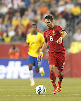Portugal midfielder Joao Moutinho (8) brings the ball forward.  In an international friendly, Brazil (yellow/blue) defeated Portugal (red), 3-1, at Gillette Stadium on September 10, 2013.