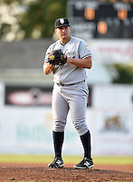 Staten Island Yankees starting pitcher Sean Carley (61) gets ready to deliver a pitch during a game against the Batavia Muckdogs on August 6, 2014 at Dwyer Stadium in Batavia, New York.  Batavia defeated Staten Island 5-3.  (Mike Janes/Four Seam Images)