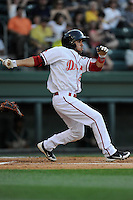 Third baseman Carlos Asuaje (20) of the Greenville Drive bats in a game against the Greensboro Grasshoppers on Wednesday, May 7, 2014, at Fluor Field at the West End in Greenville, South Carolina. (Tom Priddy/Four Seam Images)