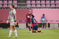 KASHIMA, JAPAN - AUGUST 5: Carli Lloyd #10 of the United States celebrates with teammates Megan Rapinoe #15 during a game between Australia and USWNT at Kashima Soccer Stadium on August 5, 2021 in Kashima, Japan.