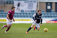 13th March 2021; Dens Park, Dundee, Scotland; Scottish Championship Football, Dundee FC versus Arbroath; Paul McMullan of Dundee races away from Dale Hilson of Arbroath