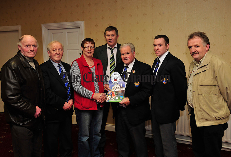 Jimmy O' Gorman, Chairman of the GAA Munster Council presents a council grant to . Also pictured are PJ Mc Guane and Robert Frost from the Munster Council, Ger Hickey of the Clare County Board, Daniel Nelligan of the Munster Council and Michael O' Neill of the Clare County Board. Photograph by Declan Monaghan