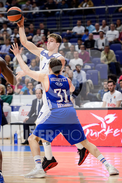 Real Madrid's Luka Doncic and Anadolu Efes's Thomas Heurtel during Turkish Airlines Euroleague match between Real Madrid and Anadolu Efes at Wizink Center in Madrid, April 07, 2017. Spain.<br /> (ALTERPHOTOS/BorjaB.Hojas)