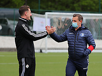 Head coach Jimmy Coenraets of OHL gives a high five to Head Coach Dave Mattheus  of AA Gent before a female soccer game between Oud Heverlee Leuven and AA Gent Ladies on the 9 th matchday of play off 1 in the 2020 - 2021 season of Belgian Womens Super League , saturday 22 nd of May 2021  in Heverlee , Belgium . PHOTO SPORTPIX.BE | SPP | SEVIL OKTEM