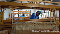 Africa, Swaziland, Malkerns.Nest organization artisan project, partnering with Rosecraft weaving  & local artisans to help market their products to global markets and better sustain their local community. Women weaving at looms.