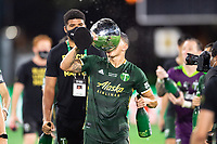 LAKE BUENA VISTA, FL - AUGUST 11: Marvin Loria #44 of the Portland Timbers lifts the trophy after a game between Orlando City SC and Portland Timbers at ESPN Wide World of Sports on August 11, 2020 in Lake Buena Vista, Florida.