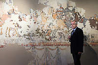 26 April 2018, Germany, Bad-Colberg-Heldburg: Georg Ulrich Grossmann, director general of the Germanisches Nationalmuseum, presents the 20-square-metre and 800-year-old mural which depicts a battle at the Deutsches Burgenmuseum (lit. German Castle Museum) at<br />