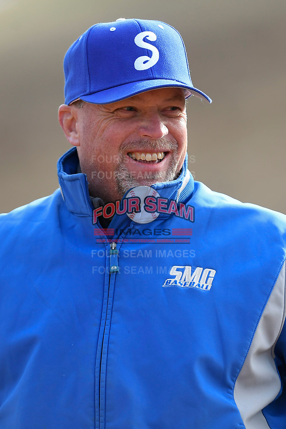 Head coach Tim Wallace of the Spartanburg Methodist College Pioneers meets with umpires before Game 2 of a junior college season-opening doubleheader against the Patrick Henry Patriots on February 3, 2018, at Mooneyham Field in Spartanburg, South Carolina. (Tom Priddy/Four Seam Images)