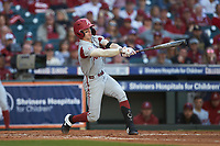 Casey Martin (15) of the Arkansas Razorbacks follows through on his swing against the Oklahoma Sooners in game two of the 2020 Shriners Hospitals for Children College Classic at Minute Maid Park on February 28, 2020 in Houston, Texas. The Sooners defeated the Razorbacks 6-3. (Brian Westerholt/Four Seam Images)