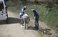 tremendous amounts of flat tires like here for Lorrenzo Manzin (FRA/FDJ) as the race ambulance rushes him by in pursuit of the peloton<br /> <br /> 33th Tro Bro Léon 2016