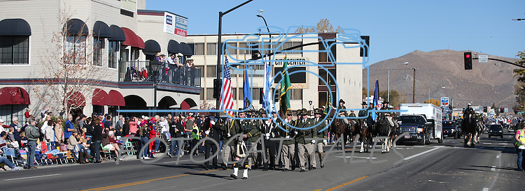 The Carson City Sheriff's Honor Guard marches in the 75th annual Nevada Day parade in Carson City, Nev., on Saturday, Oct. 26, 2013.<br /> Photo by Cathleen Allison