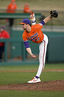 Pitcher Carter Raffield (27) of the Clemson Tigers delivers a pitch in a game against the Stony Brook Seawolves on Friday, February 21, 2020, at Doug Kingsmore Stadium in Clemson, South Carolina. Clemson won, 2-0. (Tom Priddy/Four Seam Images)
