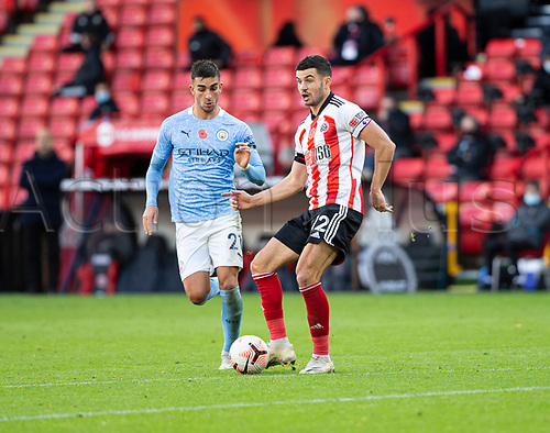 31st October 2020; Bramall Lane, Sheffield, Yorkshire, England; English Premier League Football, Sheffield United versus Manchester City; John Egan of Sheffield United passing the ball across the pitch as Ferran Torres of Manchester City comes in to tackle