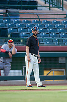 AZL Giants manager Hector Borg (13) coaches third base during the game against the AZL Reds on August 12, 2017 at Scottsdale Stadium in Scottsdale, Arizona. AZL Giants defeated the AZL Reds 1-0. (Zachary Lucy/Four Seam Images)