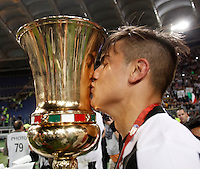 Calcio, finale Tim Cup: Milan vs Juventus. Roma, stadio Olimpico, 21 maggio 2016.<br /> Juventus' Paulo Dybala kisses the trophy at the end of the Italian Cup final football match between AC Milan and Juventus at Rome's Olympic stadium, 21 May 2016. Juventus won 1-0 in the extra time.<br /> UPDATE IMAGES PRESS/Isabella Bonotto