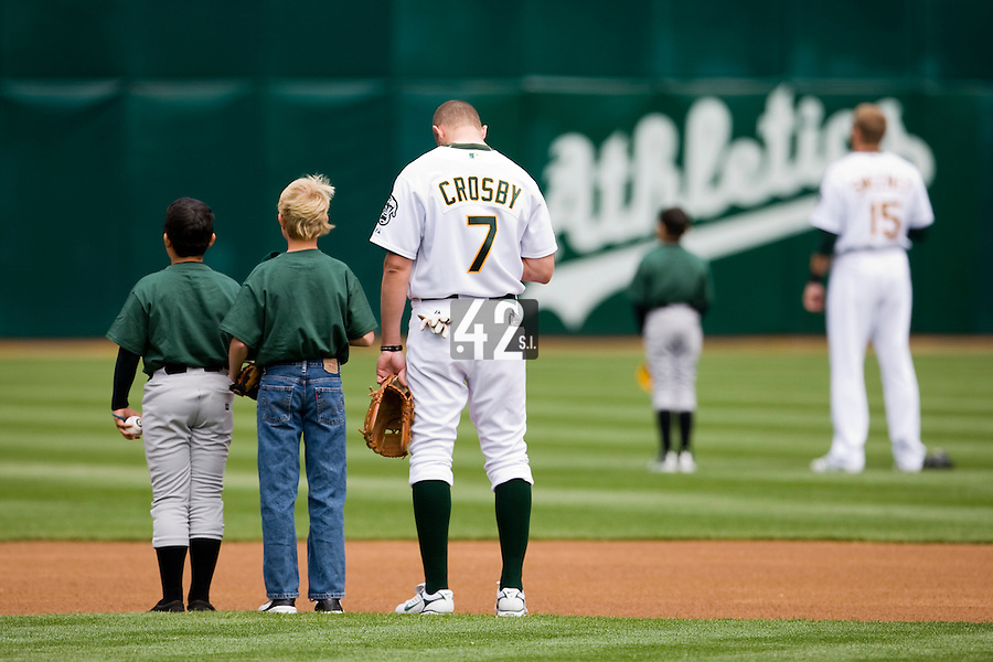 6 April 2008: A's #7 Bobby Crosby stands during the national anthem prior to the Cleveland Indians 2-1 victory over the Oakland Athletics at the McAfee Coliseum in Oakland, CA.