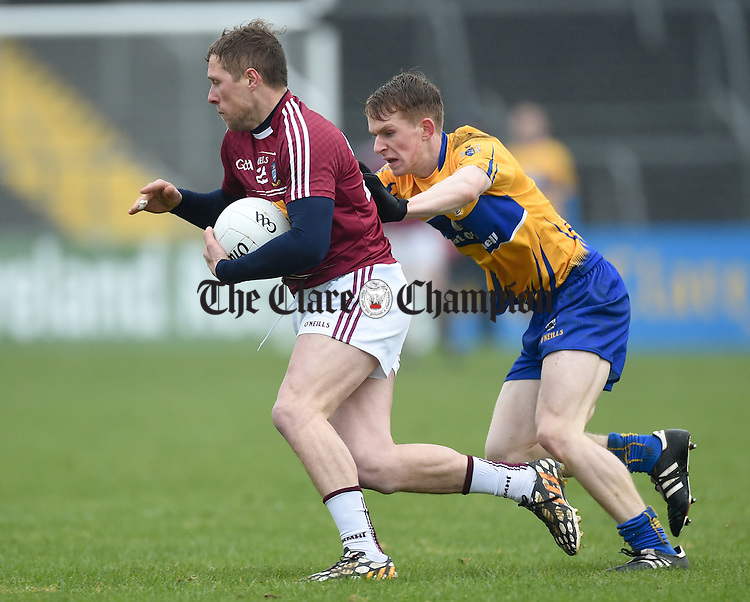 Paul Greville of Westmeath in action against Pearse Lillis of Clare during their league game in Cusack Park. Photograph by John Kelly.