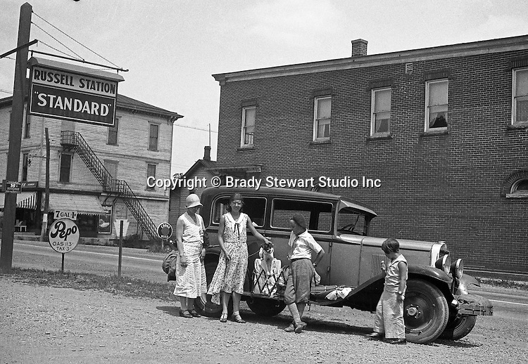 Bedford PA:  The Stewart Family out for a drive along Route 30 in their 1929 Chevy Coach. Sarah, Helen, Pepe, Brady Jr., and Sally having some ice cream.