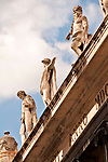 Statues on top of a building in downtown Trieste, Italy