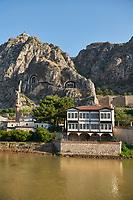 Ottoman villas of Amasya along the banks of the river Yeşilırmak, below the Pontic Royal rock tombs and mountain top ancient citadel, Turkey