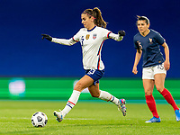 LE HAVRE, FRANCE - APRIL 13: Alex Morgan #13 of the USWNT passes the ball during a game between France and USWNT at Stade Oceane on April 13, 2021 in Le Havre, France.