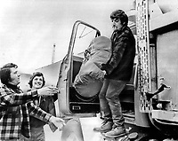 Ghislain Fillion; 32; loads survival gear - cable; shovel; axe; sleeping bag and food - into his truck in Matagami; Que.; for the 420-mile trip north to the James Bay Development Corp. power project at La Grande River; called LG2. His brothers Rodrigue; 34 (left); and Michael;17; help Fillion load the truck.<br /> <br /> 1973<br /> <br /> PHOTO :  Bob Olsen - Toronto Star Archives - AQP