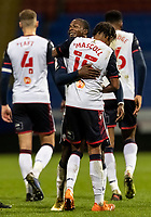Bolton Wanderers' Jamie Mascoll is congratulated by team mate Liam Gordon on scoring his side's third goal<br /> <br /> Photographer Andrew Kearns/CameraSport<br /> <br /> EFL Papa John's Trophy - Northern Section - Group C - Bolton Wanderers v Newcastle United U21 - Tuesday 17th November 2020 - University of Bolton Stadium - Bolton<br />  <br /> World Copyright © 2020 CameraSport. All rights reserved. 43 Linden Ave. Countesthorpe. Leicester. England. LE8 5PG - Tel: +44 (0) 116 277 4147 - admin@camerasport.com - www.camerasport.com