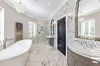BNPS.co.uk (01202 558833)<br /> Pic: Savills/BNPS<br /> <br /> Pictured: A bathroom.<br /> <br /> A striking turreted French style chateau in one of the UK's most desirable streets is on the market for £9.25m.<br /> <br /> Deauville is an impressive mansion with a striking period exterior but a stylish contemporary look inside and all the mod cons a home owner would want, including an indoor pool complex and cinema room.<br /> <br /> The house is in the prestigious St George's Hill estate in Weybridge, Surrey, which is renowned all over the world.<br /> <br /> The five-bedroom house was built in 2000 but has undergone an extensive refurbishment in the last few years.