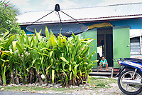 A young Tuvaluan boy sits outside a typical home in downtown Funafuti. Located in the South West Pacific Ocean, Tuvalu is the world's 4th smallest country and is one of the most vulnerable to climate change impacts including sea level rise, drought and extreme weather events. Tuvalu - March, 2019.