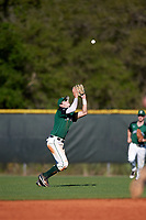 Dartmouth Big Green shortstop Nate Ostmo (5) catches a popup during a game against the Northeastern Huskies on March 3, 2018 at North Charlotte Regional Park in Port Charlotte, Florida.  Northeastern defeated Dartmouth 10-8.  (Mike Janes/Four Seam Images)