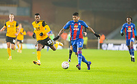 8th January 2021; Molineux Stadium, Wolverhampton, West Midlands, England; English FA Cup Football, Wolverhampton Wanderers versus Crystal Palace; Patrick van Aanholt of Crystal Palace breaks forward with the ball at his feet chased by Nelson Semedo of Wolverhampton Wanderers