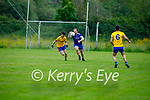 Eamon Hickson of Annascaul tries to stay ahead of Mike Hoare Ballymac in the opening game of division 2b of the County Football League