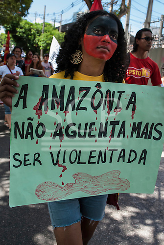 """Belem, Para State, Brazil. Demonstration against the construction of the Belo Monte hydroelectric dam, 20th August 2011. Girl with hand-written sign """"Amazonia will not continue to suffer being violated""""."""
