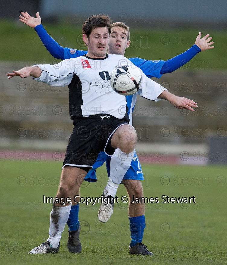 City's Joe Dingwall holds off Queen of the South's Daniel Carmichael ...
