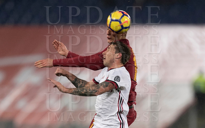 Calcio, Serie A: AS Roma - AC Milan, Roma, stadio Olimpico, 25 febbraio, 2018.<br /> Roma's Patrik Schick (r) in action with Milan's Lucas Biglia (l) during the Italian Serie A football match between AS Roma and AC Milan at Rome's Olympic stadium, February 28, 2018.<br /> UPDATE IMAGES PRESS/Isabella Bonotto