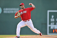 Starting pitcher Dedgar Jimenez (47) of the Greenville Drive delivers a pitch in a game against the Greensboro Grasshoppers on Thursday, July 14, 2016, at Fluor Field at the West End in Greenville, South Carolina. Greenville won, 3-1. (Tom Priddy/Four Seam Images)