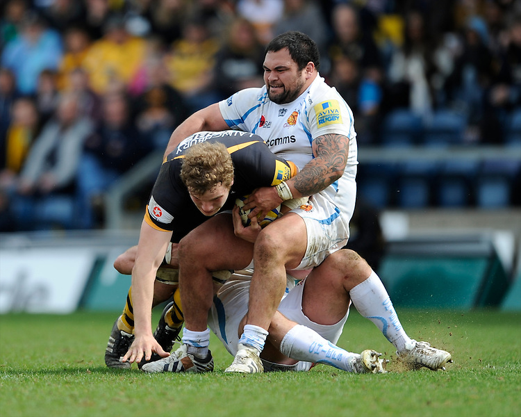 Hoani Tui of Exeter Chiefs brings down Joe Launchbury of London Wasps during the Aviva Premiership match between London Wasps and Exeter Chiefs at Adams Park on Sunday 21st April 2013 (Photo by Rob Munro)