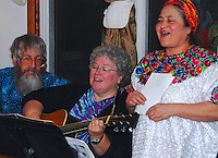 Sandra Rybachek (right) hosts Las Posadas, a traditional nine-day celebration leading up to Christmas Eve. Sandra sings here with Tom and Mary Ray Worley Saturday night, December 22, 2007, in Madison.