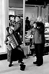 Old age pensioners , husband and wide busking on the streets of Blackburn Lancashire UK 1983.