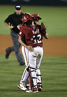 Arkansas Kevin Kopps (45) and catcher Casey Opitz (12) , Saturday celebrate, June 5, 2021 during the ninth inning in the second game of the NCAA Fayetteville Regional at Baum-Walker Stadium in Fayetteville. Check out nwaonline.com/210606Daily/ for today's photo gallery. <br /> (NWA Democrat-Gazette/Charlie Kaijo)