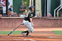 Bristol Pirates catcher Yoel Gonzalez (13) swings at a pitch during a game against the Elizabethton Twins at Joe O'Brien Field on July 30, 2016 in Elizabethton, Tennessee. The Twins defeated the Pirates 6-3. (Tony Farlow/Four Seam Images)