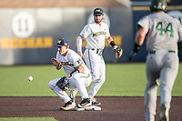 Michigan Wolverines second baseman Jimmy Kerr (15) prepares to catch a throw at second as shortstop Michael Brdar (9) watches on during the NCAA baseball game against the Eastern Michigan Eagles on May 16, 2017 at Ray Fisher Stadium in Ann Arbor, Michigan. Michigan defeated Eastern Michigan 12-4. (Andrew Woolley/Four Seam Images)