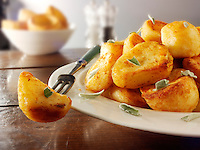 Traditional British roast potatoes stock photos