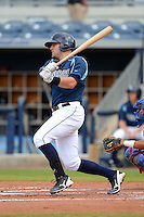 Charlotte Stone Crabs designated hitter Curt Casali (9) at bat during a game against the Daytona Cubs on July 19, 2013 at Charlotte Sports Park in Port Charlotte, Florida.  The game was called in the seventh inning tied at zero due to rain.  (Mike Janes/Four Seam Images)