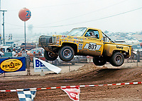 Walker Evans races to victory in a yellow 350 hp Chevy Silverado pickup owned and prepared by Parnelli Jones at the AC-Delco World Championships of Off-Road Racing, Riverside  International Raceway, Riverside, CA, Sept 5, 1975. Photo by John G. Zimmerman